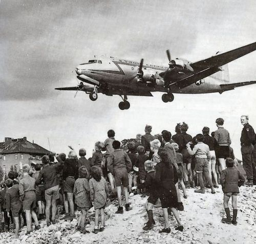 Berliners watching a C-54 land at Berlin Tempelhof Airport, 1948.